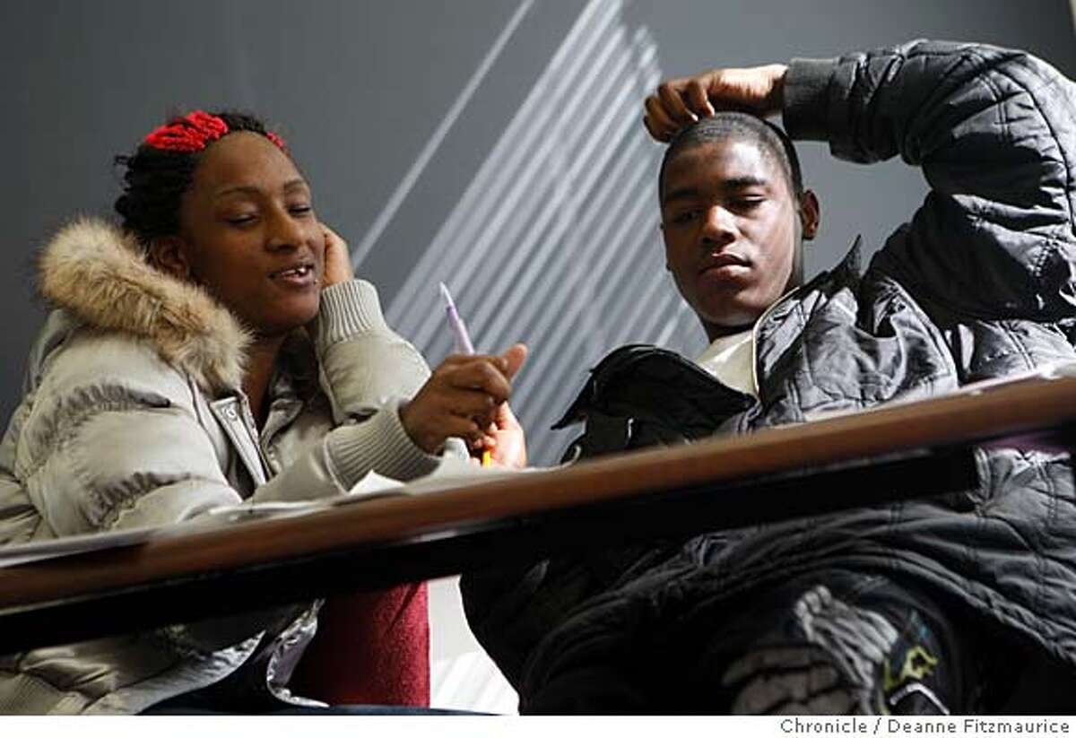 Jacqueela Winston, 17, and her brother Tyshawn Guilory, 16, work together on a math problem in San Francisco's new truancy center at the YMCA Bayview on February 28, 2008 in San Francisco, Calif. Photo by Deanne Fitzmaurice / San Francisco Chronicle Ran on: 03-02-2008 Jacqueela Winston and her brother Tyshawn Guilory leave the CARE center for lunch, which is donated by local restaurants. Ran on: 03-02-2008 Jacqueela Winston and her brother Tyshawn Guilory leave the CARE center for lunch, which is donated by restaurants.