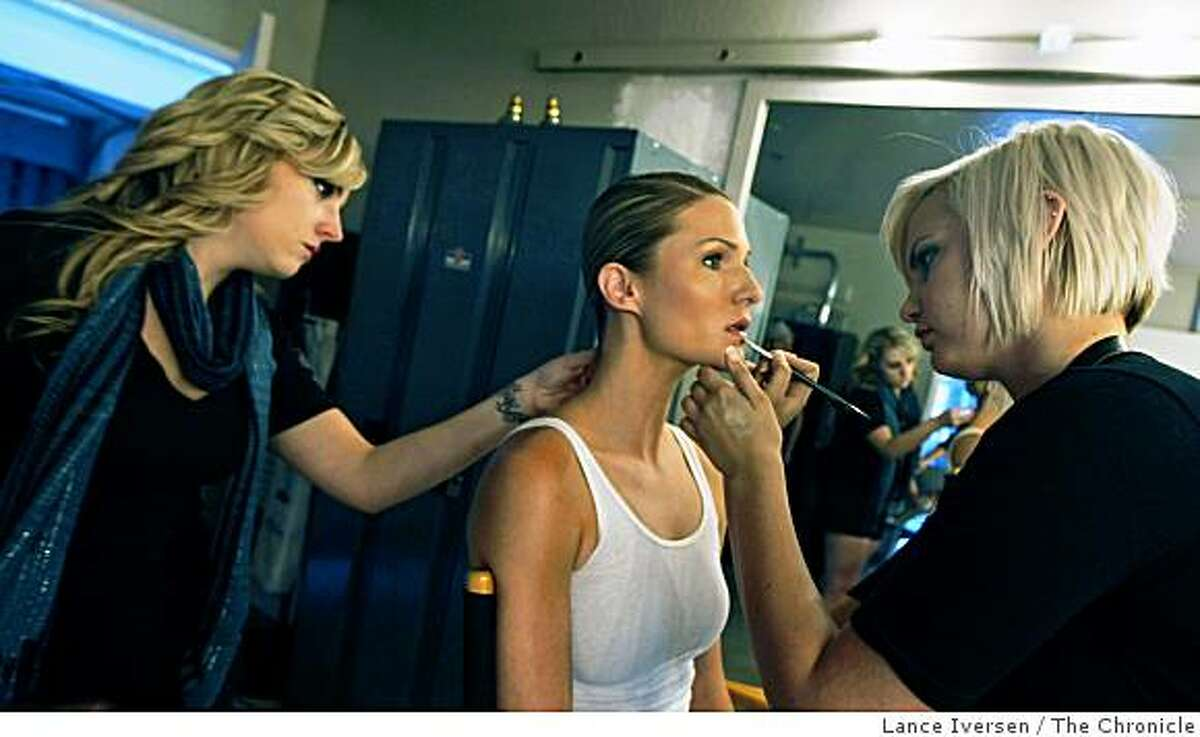 Student hair stylist Shannon Rice left and student make up artist Laura Raffo work on Joliet LaBonte one of dozens of models who worked the annual San Francisco Art Institute student fashion show Saturday June 20, 2009 at the San Francisco Design Center.