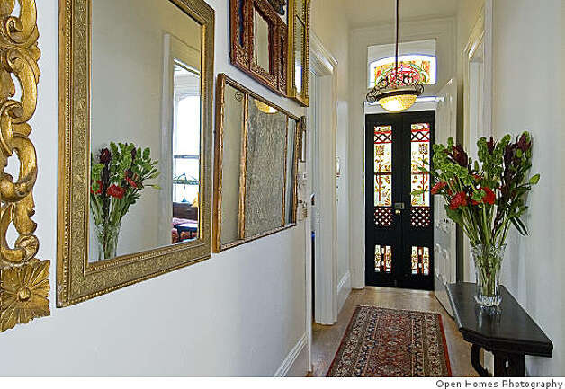 The long central hallway with the front door at the end. Photo: Open Homes Photography