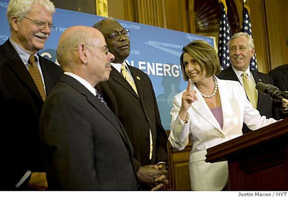 House Speaker Nancy Pelosi (D-Calif.) is joined by, from left, Representatives George Miller (D-Calif.), Henry Waxman (D-Calif.), James Clyburn (D-S.C.) House Majority Leader Steny Hoyer (D-Md.) as she speaks to reporters in Washington on Friday, June 26, 2009. The House passed legislation on Friday intended to address the threat of global warming and transform the way the United States produces and uses energy. (Justin Maxon/The New York Times)