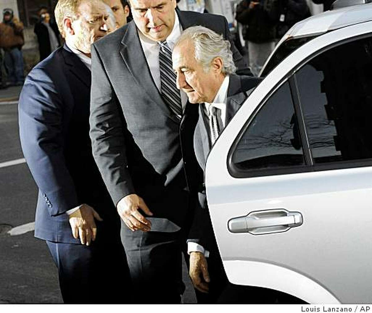 FILE - In this March 12, 2009 file photo, Bernard Madoff arrives at Manhattan federal court in New York. Some victims were expected to call for harsh punishment at the disgraced financier's sentencing Monday, June 29, 2009 in federal court in Manhattan. Ten have told U.S. District Judge Denny Chin they wish to speak out in court. (AP Photo/ Louis Lanzano, file)