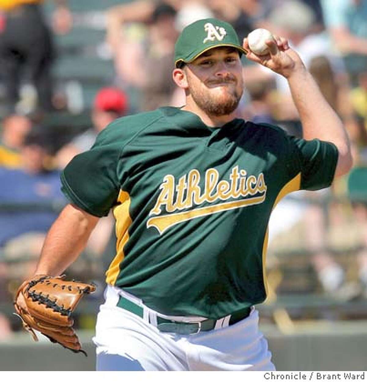 A's starting pitcher Dana Eveland threw over to first to try to catch a runner early in the game. On March 2, 2008 the Oakland Athletics played the Colorado Rockies in a spring training exhibition game at Phoenix Municipal Stadium. Photo by Brant Ward / San Francisco Chronicle