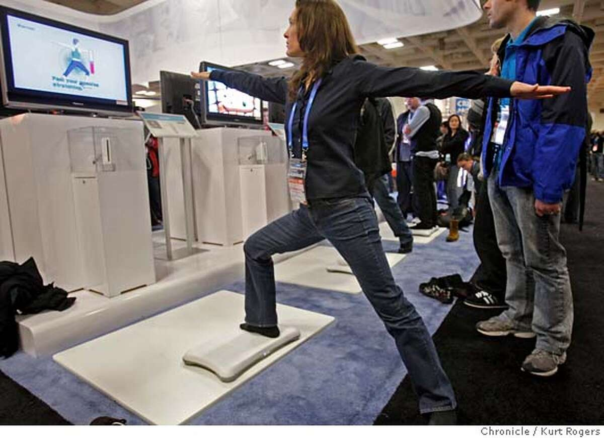 Devin Williams of Portland, Ore., tries out the new Wii board at the Game Developer's Conference at Moscone center in San Francisco, Calif., on Friday February 22, 2008. Photo By Kurt Rogers / San Francisco Chronicle MANDATORY CREDIT FOR PHOTOG AND SAN FRANCISCO CHRONICLE/NO SALES-MAGS OUT