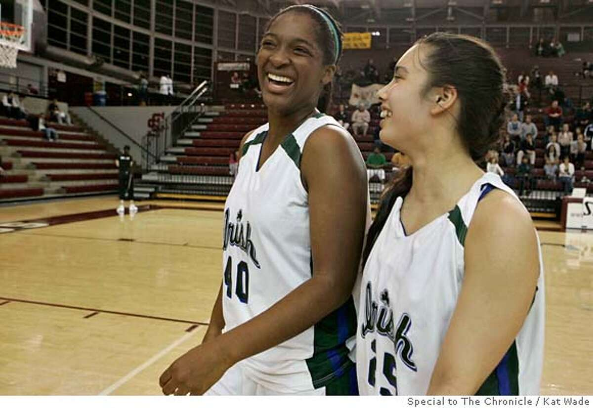Sacred Heart Irish Kamilah Jackson , left, and Rosslyn Beard share a laugh after beating the St. Ignatius Wildcats during the Central Coast Section Division iii finasl at the Leavey Center in Santa Clara, Calif. on Friday, Feb 29, 2008. Photo by Kat Wade / special to The Chronicle