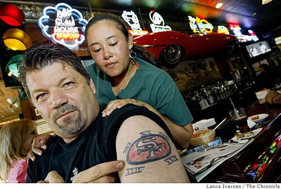 "Matt Matelli shows off his tattoo to his friends and girl friend Anita Jerez both from San Francisco at The Clam House on Thursday July 2, 2009. ""It says San Francisco on my arm,"" said Matelli when asked about the potential move. ""That represents the 49ers."" Photo: Lance Iversen, The Chronicle"