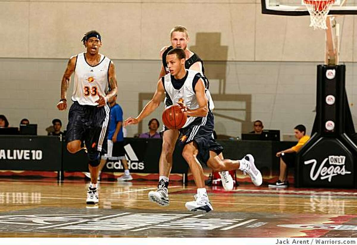 Stephen Curry, of the Golden State Warriors moves the ball upcourt in a Summer League game in Las Vegas, NV on Friday, July 10, 2009.