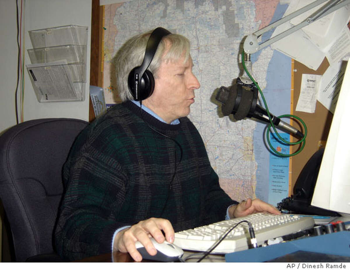 News anchor Brad Williams reads an item over the air at a La Crosse, Wis., radio station Wednesday Jan. 30, 2008 . Williams, 51, is one of two people in the world believed to have a