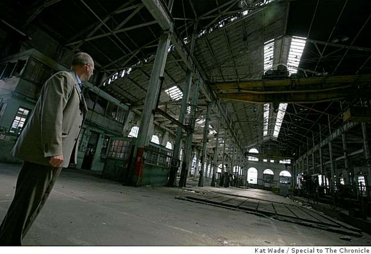 David Beaupre, the Pier 70 project manager stands, in the huge interior of the Union Ironworks Machine Shop at Pier 70 in San Francisco, Calif. on Thursday, July 9, 2009. Built in 1886, and then enlarged in 1918, the shop held a giant lathe to cut ship drive shafts and operated three 30-ton overhead cranes.