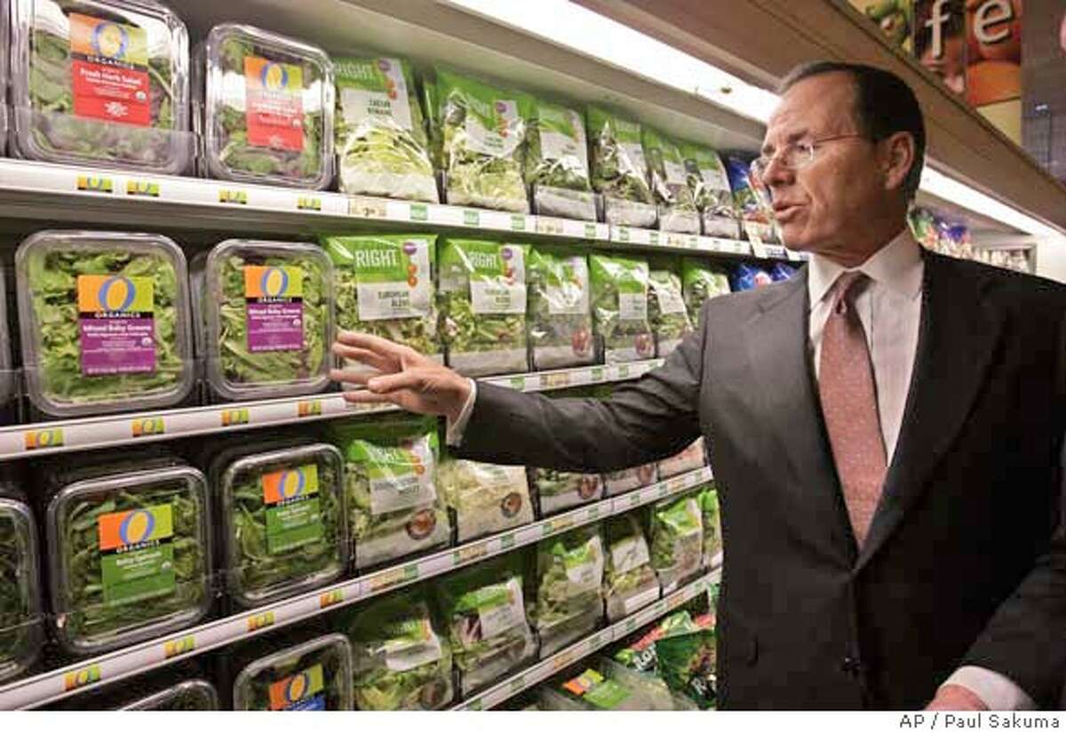 Safeway CEO Steve Burd looks at produce at a Safeway store in Dublin, Calif., Friday, Jan. 18, 2008. Grocery store operator Safeway on Thursday, Feb. 21, 2008 said its profit fell 2 percent in the fourth quarter because of a tax gain that inflated earnings a year ago. (AP Photo/Paul Sakuma) NOT FILE PHOTO