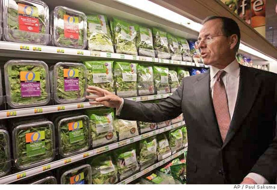 Safeway CEO Steve Burd looks at produce at a Safeway store in Dublin, Calif., Friday, Jan. 18, 2008. Grocery store operator Safeway on Thursday, Feb. 21, 2008 said its profit fell 2 percent in the fourth quarter because of a tax gain that inflated earnings a year ago. (AP Photo/Paul Sakuma) NOT FILE PHOTO Photo: Paul Sakuma