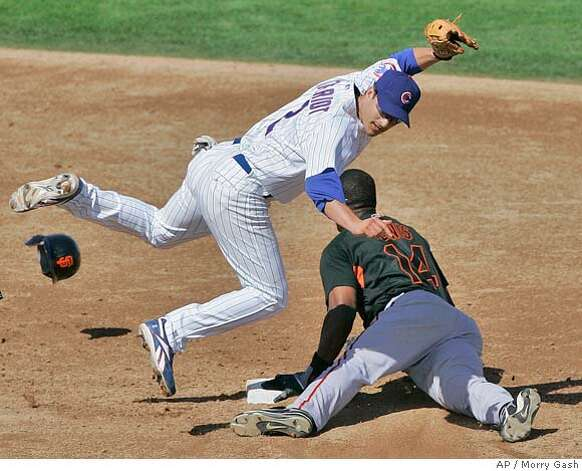 Chicago Cubs' Ryan Theriot tags out San Francisco Giants' Fred Lewis (14) as he tries to steal second during the fourth inning at a baseball spring training game Sunday, March 2, 2008, in Mesa, Ariz. (AP Photo/Morry Gash) Photo: Morry Gash