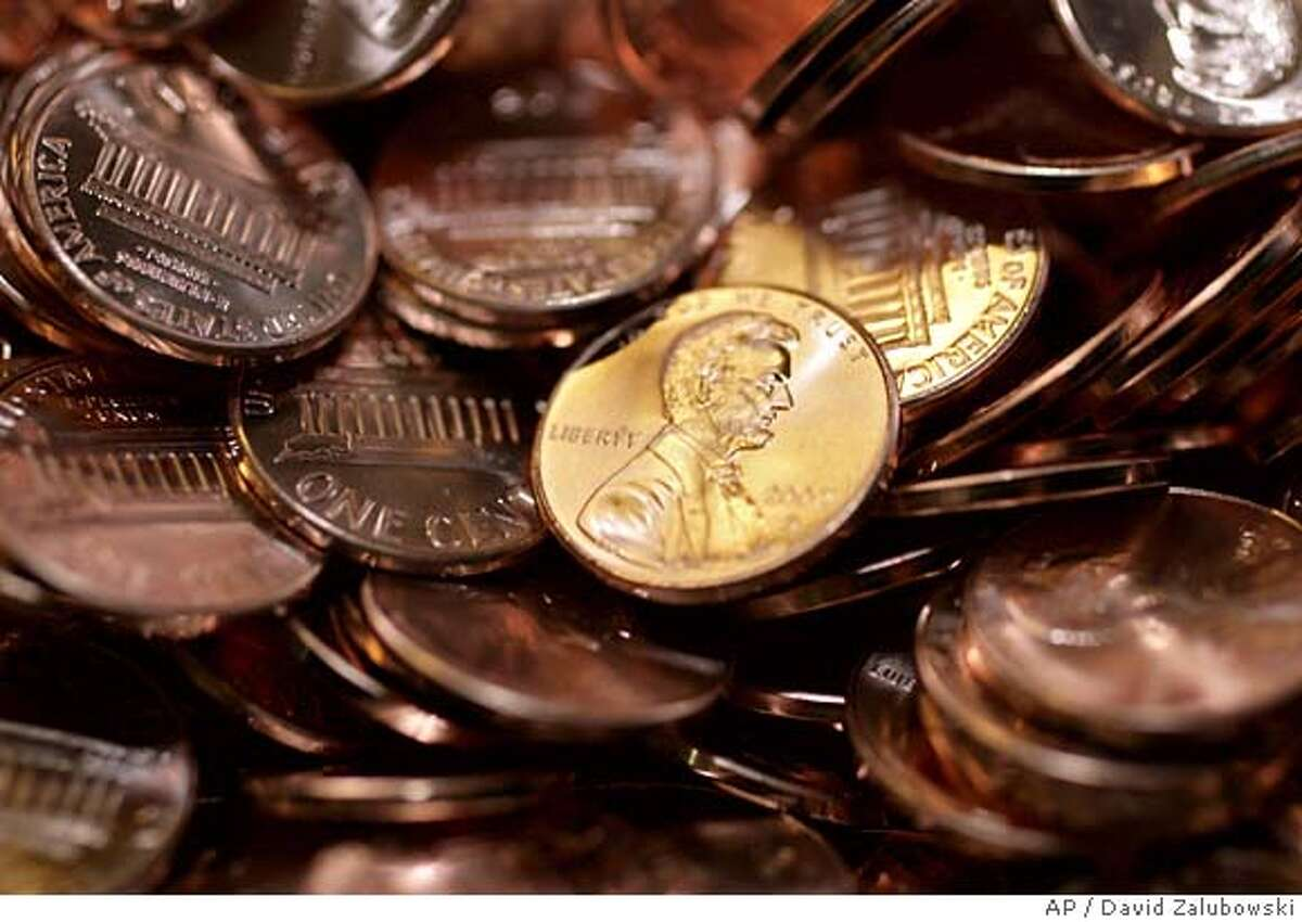 ###Live Caption:Asked Friday whether he thought the penny should be eliminated Treasury Secretary Henry Paulson said it would make sense but doesn't think it's politically doable.###Caption History:Pennies sit in a bin at the U.S. Mint in Denver on Wednesday, Aug. 15, 2007. Because of a surge in the price of zinc and copper, it now costs the U.S. Mint almost 2 cents to produce a penny. That has some in Congress seeking a change in the way the coins are made, if not removing them circulation altogether. The the nation's sole supplier of zinc