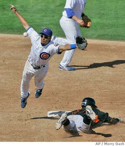 Chicago Cubs' Eric Patterson makes a diving attempt at a throw as San Francisco Giants' Eugenio Velez steals second during the fifth inning at a baseball spring training game Sunday, March 2, 2008, in Mesa, Ariz. (AP Photo/Morry Gash) Photo: Morry Gash