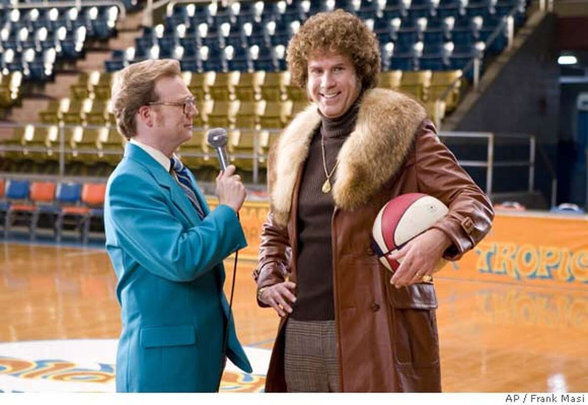 This undated photo released by New Line Cinema shows Will Ferrell, right, portraying Jackie Moon and Andrew Daly portraying Dick Pepperfield in the movie