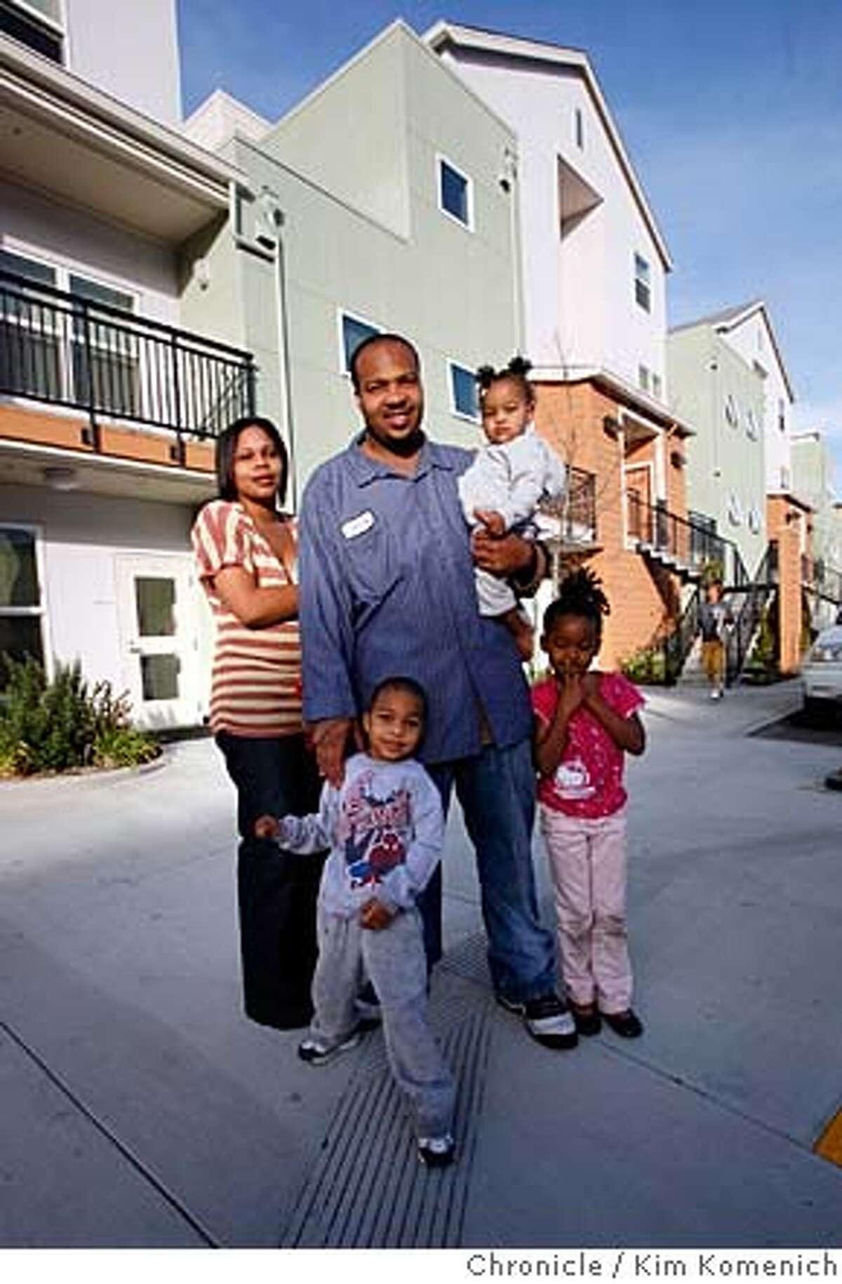 cq Jonta, Johntay, Kymonnie) Kelly and Jonta Davenport and their children, Heaven, 1, (in Jonta's arms), Johntay, 3, front left, and Kymonnie, 6 , front right, Feb. 26, 2008 in front of the Giant Road Family Apartments in San Pablo, Cs. Photo by Kim Komenich / San Francisco Chronicle MANDATORY CREDIT FOR PHOTOG AND SAN FRANCISCO CHRONICLE. NO SALES- MAGS OUT.