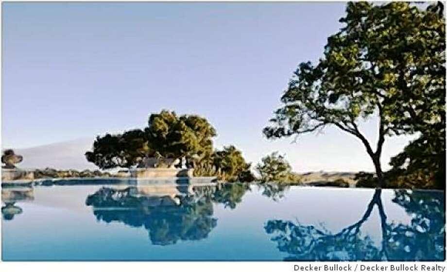 An infinity pool boasts view of the hills. Photo: Decker Bullock, Decker Bullock Realty