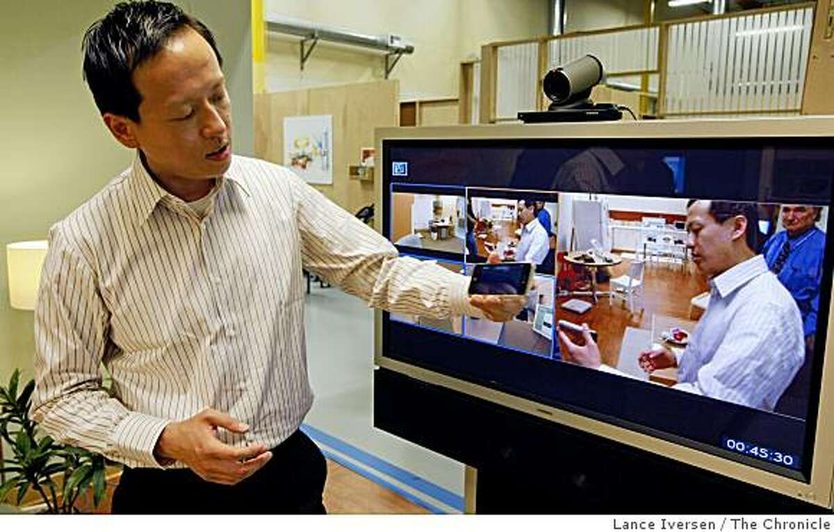 Sean Chai demonstrates new technology that allows caregivers to interact with patients at home.