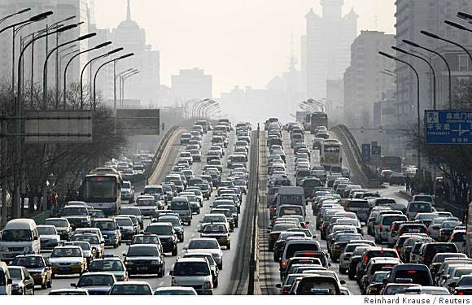 Cars are driven on one of the ring roads in Beijing's city centre in this January 15, 2008 file photo. Officials reportedly plan to keep half of Beijing's 3 million cars off the roads during the Games, which begin August 8. Authorities have also ordered Beijing and five surrounding provinces to cut industrial pollution for two months from late July.  Picture taken January 15, 2008. To match feature OLYMPICS-BEIJING/POLLUTION    REUTERS/Reinhard Krause (CHINA) Photo: Reinhard Krause, Reuters