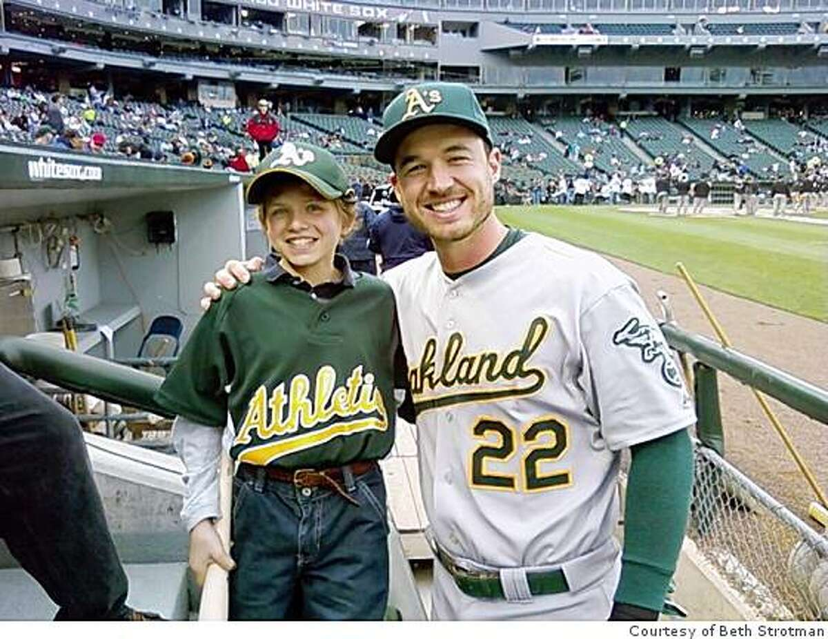Oakland Athletics outfielder Jack Hannahan poses for a picture with Luke Strotman at U.S. Cellular Field in Chicago, Illinois on June 1, 2009.