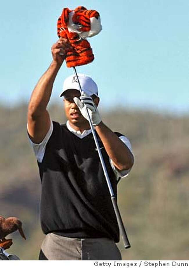 MARANA, AZ - FEBRUARY 20: Tiger Woods hits takes the cover off of his driver on the 17th hole during the first round matches of the WGC-Accenture Match Play Championship at The Gallery at Dove Mountain on February 20, 2008 in Marana, Arizona. (Photo by Stephen Dunn/Getty Images) Photo: Stephen Dunn