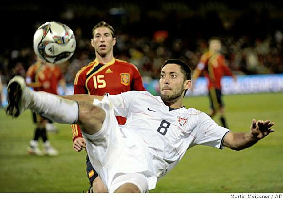 USA's Clint Dempsey, right, controls the ball as Spain's Sergio Ramos, left, looks on during their Confederations Cup semifinal soccer match at Free State Stadium in Bloemfontein, South Africa, Wednesday, June 24, 2009. The US won 2-0 and advanced to the final. (AP Photo/Martin Meissner) Photo: Martin Meissner, AP