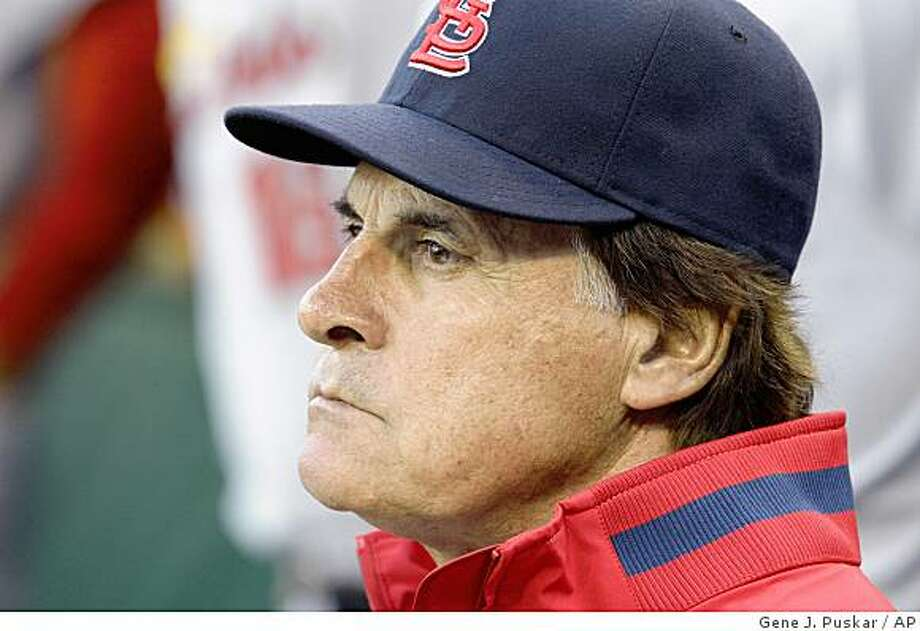 In this May 12, 2009 file photo, St. Louis Cardinals manager Tony La Russa is seen during a baseball game against the Pittsburgh Pirates in Pittsburgh. La Russa has quietly dropped his lawsuit against the social networking site Twitter Inc. A one-paragraph statement filed June 26 with the U.S. District Court in San Francisco said La Russa had dropped all claims _ and that San Francisco-based Twitter did not compensate him in exchange. (AP Photo/Gene J. Puskar, file) Photo: Gene J. Puskar, AP