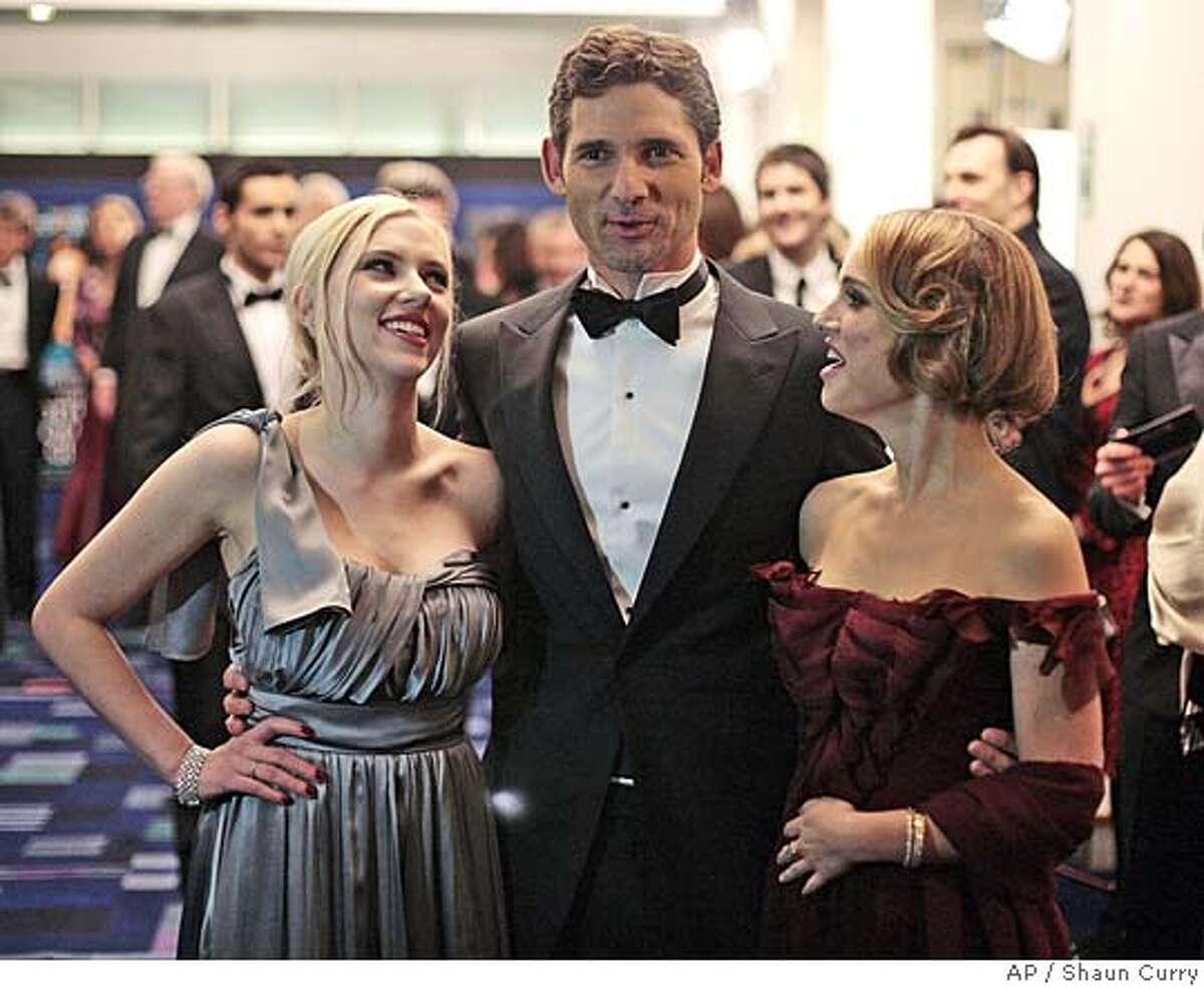 US actors Natalie Portman, right, Scarlett Johansson and Australian Eric Bana, center, attend the royal film Premiere of