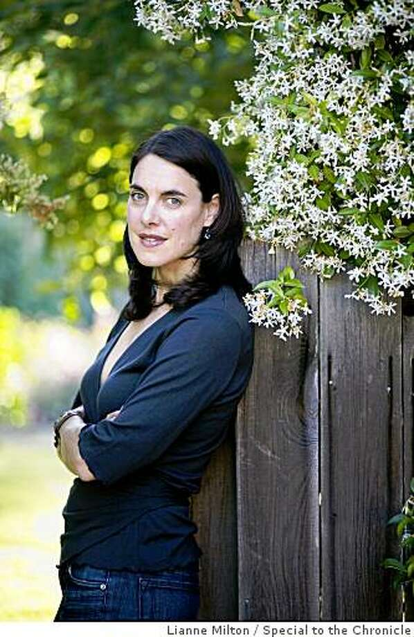 Writer Holly Payne in her garden at home, in Mill Valley, Calif., on Tuesday, June 23, 2009. Payne will feature a book release of her new novel, Kingdom of Simplicity, at Litquake, on Thursday July 9. Photo: Lianne Milton, Special To The Chronicle
