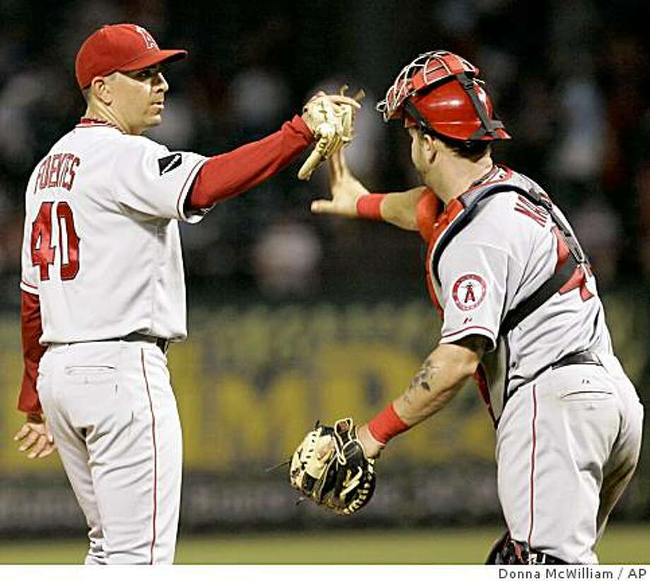 Los Angeles Angels closer Brian Fuentes (40) celebrates with Angels catcher Mike Napoli, right, after a baseball game against the Texas Rangers in Arlington, Texas, Monday, June 29, 2009. The Angels won 5-2. (AP Photo/Donna McWilliam) Photo: Donna McWilliam, AP