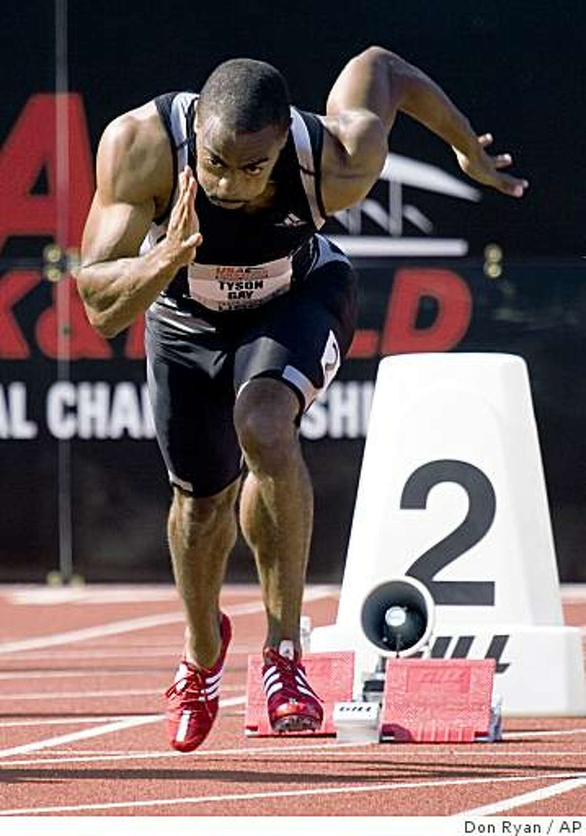 Sprinter Tyson Gay shoots out of the blocks on his way to winning his preliminary heat during the 100 meters on the first day of the U.S. track and field championships in Eugene, Ore., Thursday, June 25, 2009. Gay finished with a wind-aided time of 9.75 seconds. (AP Photo/Don Ryan)