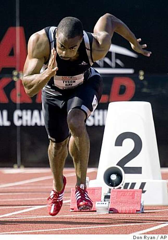 Sprinter Tyson Gay shoots out of the blocks on his way to winning his preliminary heat during the 100 meters on the first day of the U.S. track and field championships in Eugene, Ore., Thursday, June 25, 2009. Gay finished with a wind-aided time of 9.75 seconds. (AP Photo/Don Ryan) Photo: Don Ryan, AP