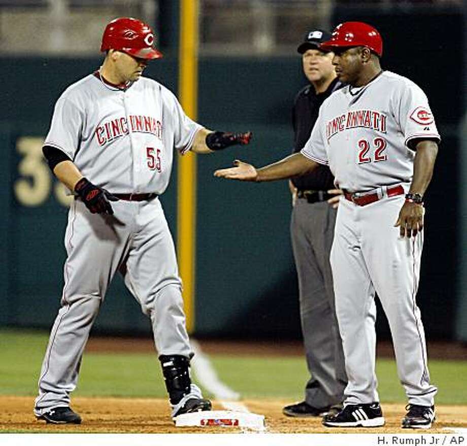 Cincinnati Reds' Ramon Hernandez, left, celebrates with first base coach Billy Hatcher (22) after Hernandez hit a one-run single against the Philadelphia Phillies in the ninth inning of a baseball game Tuesday, July 7, 2009, in Philadelphia. The Reds won 4-3.  (AP Photo/H. Rumph Jr.) Photo: H. Rumph Jr, AP