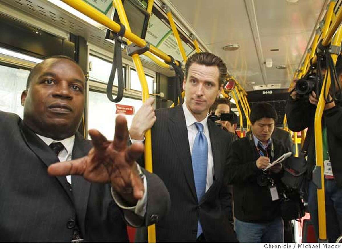 Executive Director/CEO of San Francisco Municipal Transportation Agency, left, along with Mayor Gavin Newsom check out the new MUNI bus and it's new features. Photo by Michael Macor/ San Francisco Chronicle , on 2/20/08