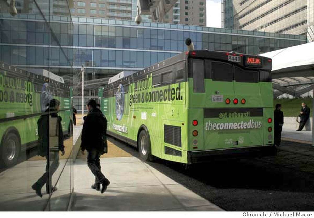 The new bus brightly covered in green paint and many messages. Photo by Michael Macor/ San Francisco Chronicle , San Francisco, Ca, on 2/20/08