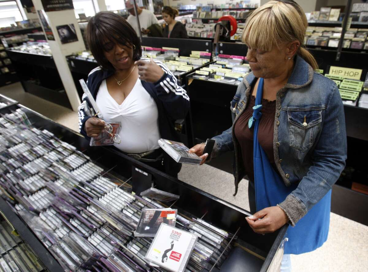 Brenda Ferguson (left) and Kathryn Johnson scoop up Michael Jackson CDs at Rasputin's Records on Powell Street in San Francisco, Calif., on Thursday, June 25, 2009 after word spread of the pop star's death.