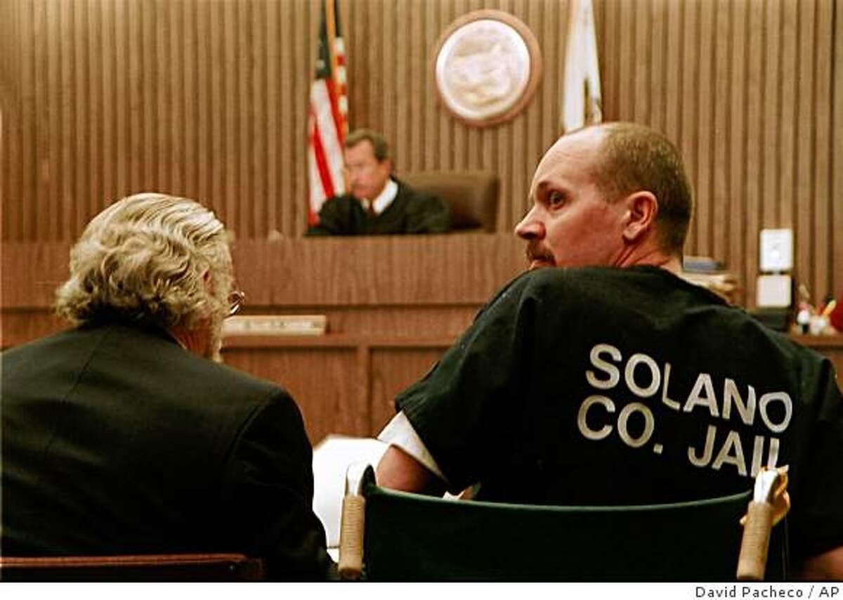 Curtis Dean Anderson looks over his shoulder during his sentencing by Solano County Superior Court Judge Allan P. Carter, in background, Thursday, July 12, 2001 in Vallejo, Calif. Anderson who kidnapped and sexually assaulted an 8-year-old girl was sentenced to life in prison as a packed courtroom cheered and applauded.
