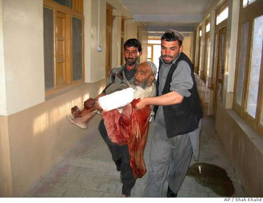 An Afghan victim of a suicide car bombing in Kandahar is carried into a hospital in Chaman, Pakistan for treatment, Monday, Feb. 18, 2008. A suicide car bomber killed 38 Afghans at a crowded market Monday, pushing the death toll from two days of militant bombings to about 140. The marketplace bombing, which targeted a Canadian military convoy, came one day after Afghanistan's deadliest insurgent attack since the Taliban's ouster in 2001. (AP Photo/Shah Khalid) Photo: Shah Khalid