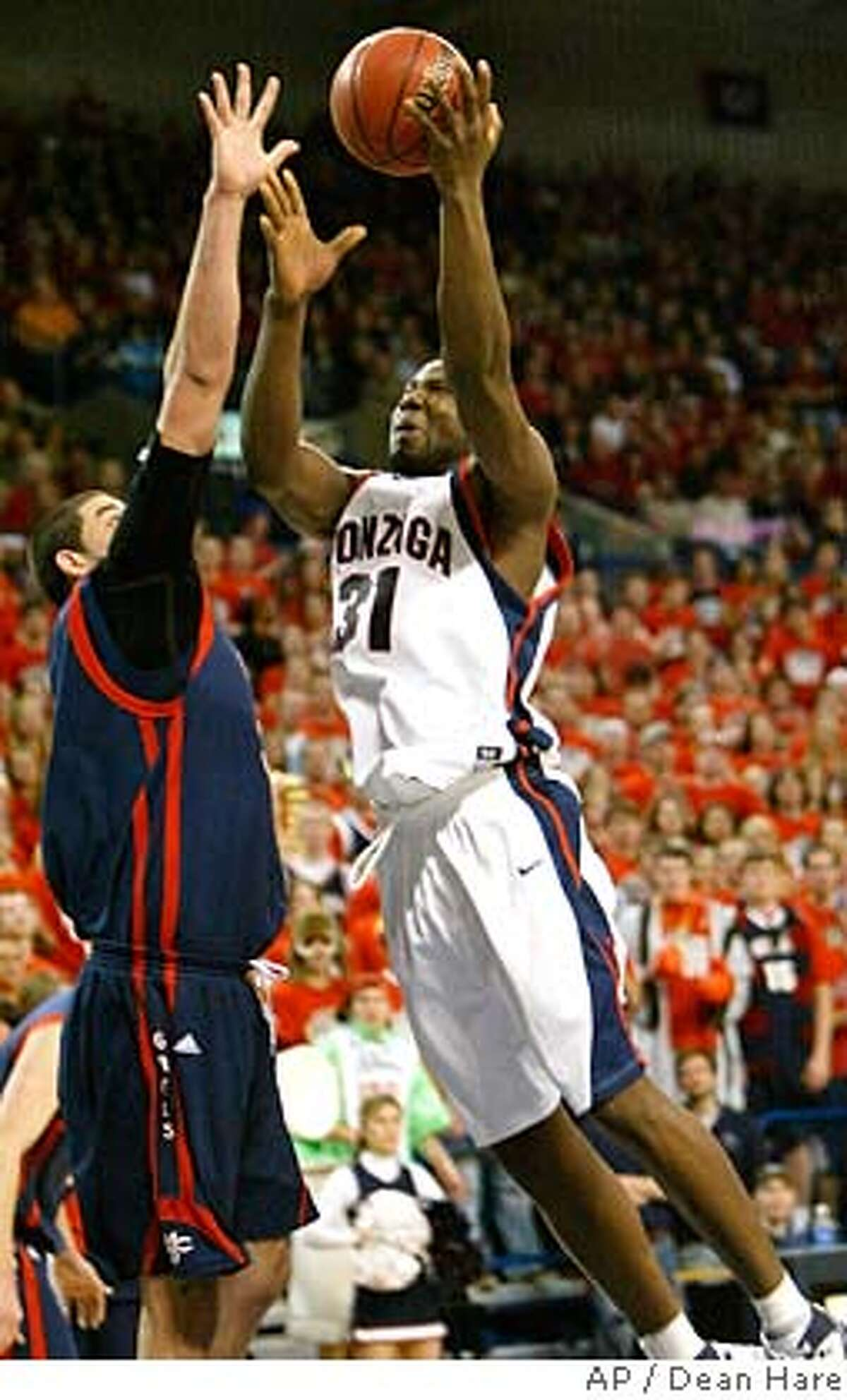 ###Live Caption:Gonzaga forward Abdullahi Kuso shoots over Saint Mary's center Omar Samhan during the first half of a basketball game Saturday, March 1, 2008, at the McCarthey Athletic Center in Spokane, Wash. (AP Photo/Dean Hare)###Caption History:Gonzaga forward Abdullahi Kuso shoots over Saint Mary's center Omar Samhan during the first half of a basketball game Saturday, March 1, 2008, at the McCarthey Athletic Center in Spokane, Wash. (AP Photo/Dean Hare)###Notes:Abdullahi Kuso, Omar Samhan###Special Instructions:EFE OUT