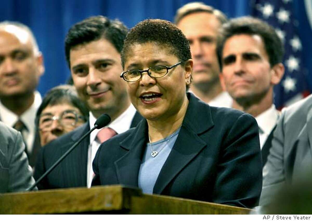 Assembly Majority Leader Karen Bass, D-Los Angeles, center, is joined by fellow legislators as she speaks at a news conference after she was elected to become the next speaker of the California State Assembly at the Capitol in Sacramento, Calif., on Thursday, Feb. 28, 2008.(AP Photo/Steve Yeater)