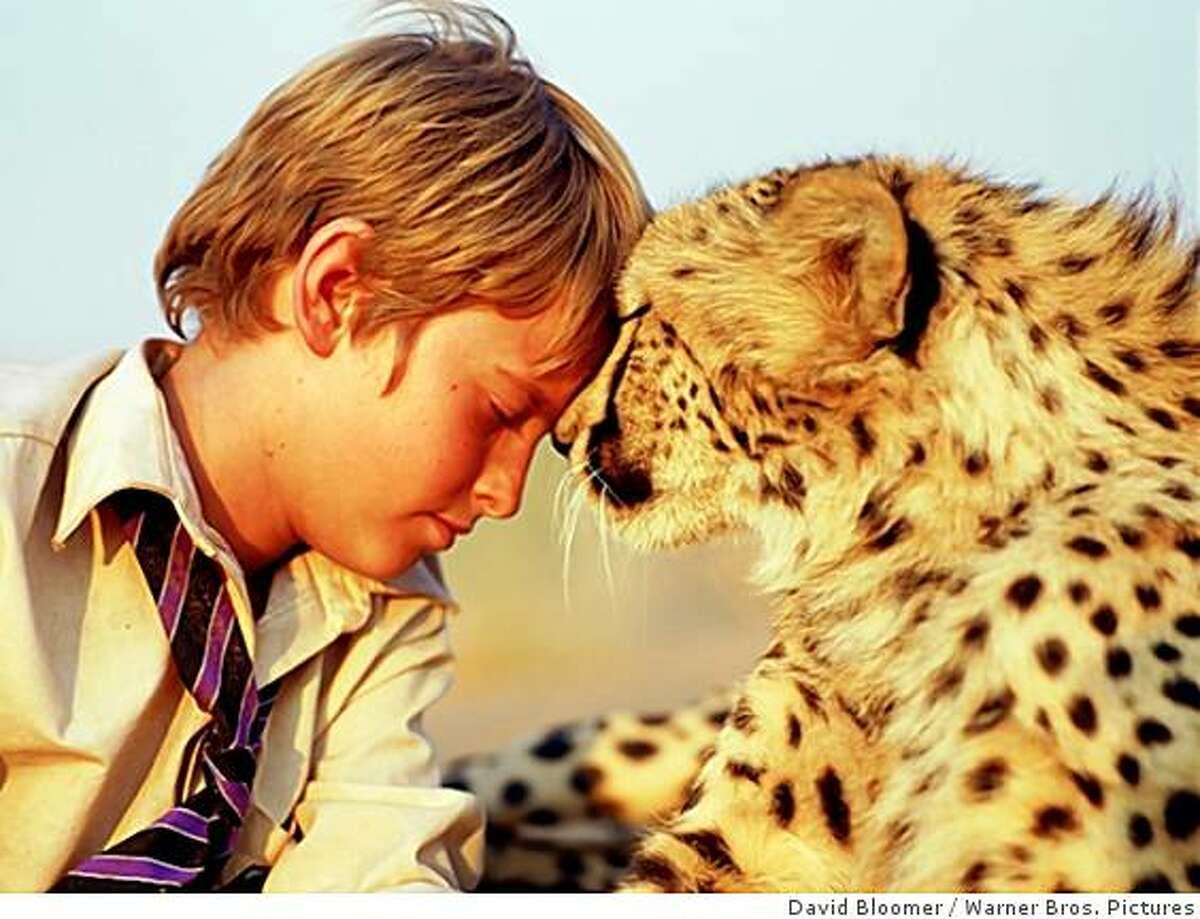 ALEX MICHAELETOS as Xan and his lovable cheetah Duma, in Warner Bros. Pictures?• family adventure ?'Duma.?