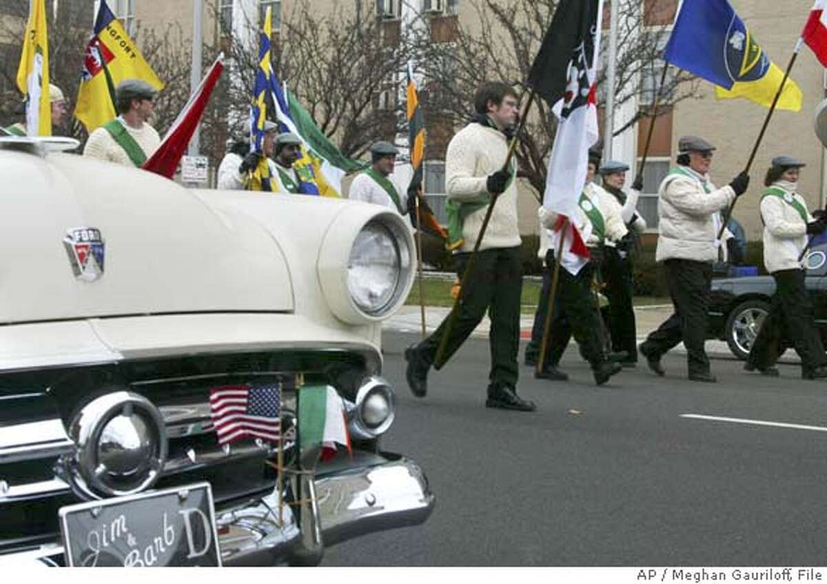 ** FILE ** In this March 17, 2007 file photo, members of the Shamrock Club march and fly their flags during the St. Patrick's Day Parade in Columbus, Ohio. St. Patrick's Day, famous for raucous partying, falls during the Catholic Holy Week this year, causing local clergy to ask that all celebrations be moved to another date. Columbus Bishop Frederick Campbell has asked local pastors to celebrate the patron saint a week early instead. (AP Photo/The Columbus Dispatch, Meghan Gauriloff, File) A MARCH 17, 2007 FILE PHOTO