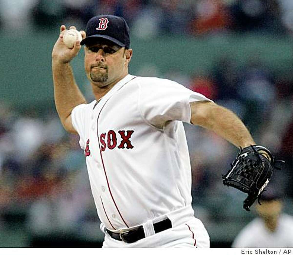 Boston Red Sox starter Tim Wakefield delivers to the Oakland Athletics during the first inning of their baseball game at Fenway Park in Boston, Wednesday, July 8, 2009.