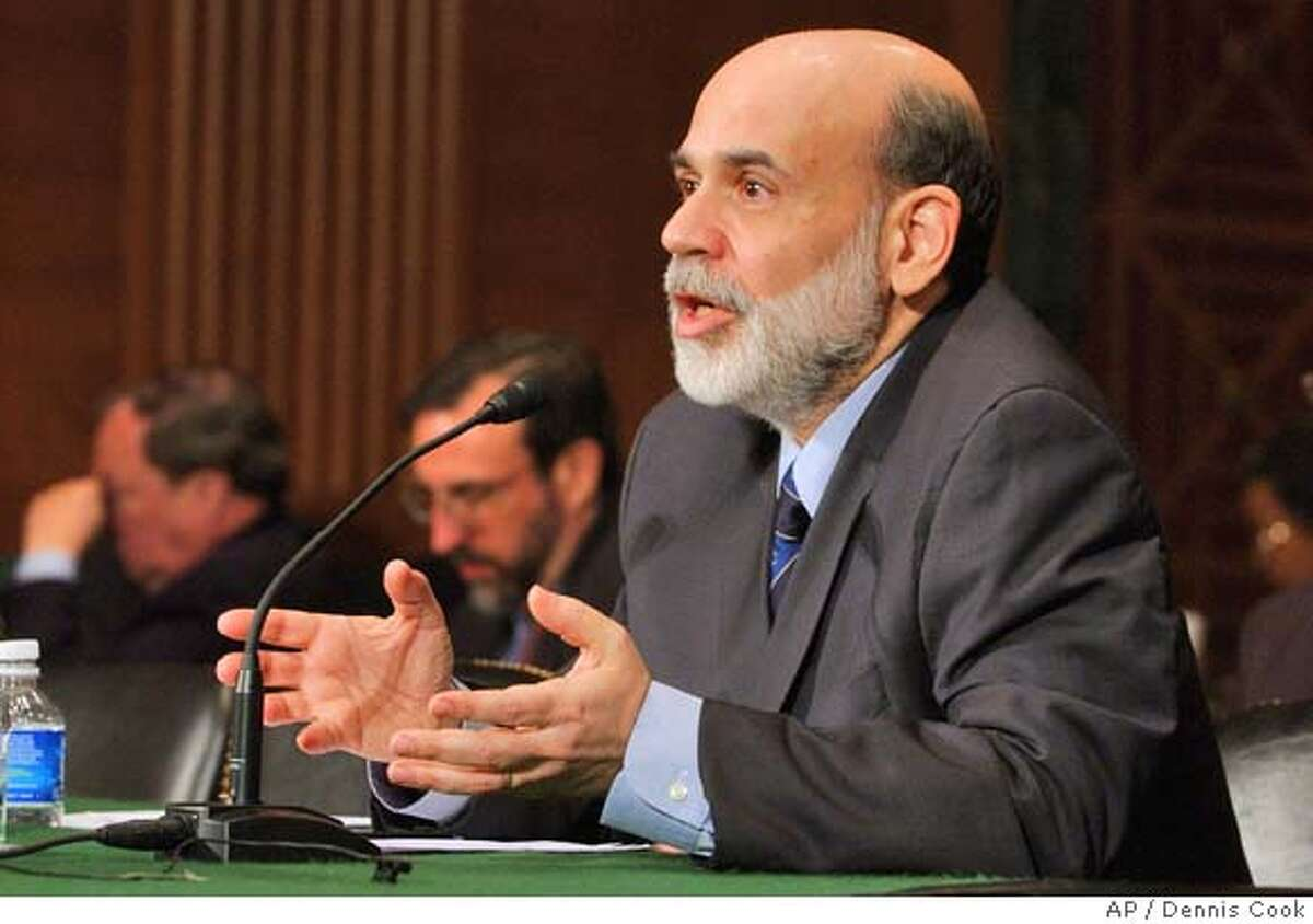 Federal Reserve Chairman Ben Bernanke delivers the Fed's Monetary Policy Report, Thursday, Feb. 28, 2008, during an appearance before the Senate Banking Committee. (AP Photo/Dennis Cook)