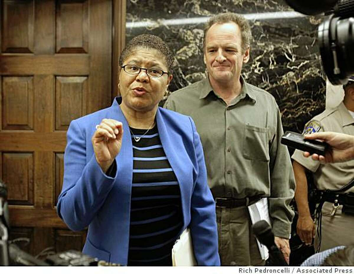 Assembly Speaker Karen Bass, D-Los Angeles, talks with reporters as she and Assembly Minority Leader Sam Blakeslee, R-San Luis Obispo leave Gov. Arnold Schwarzenegger's Capitol office during a break in a budget negotiations in Sacramento, Calif., Friday, July 10, 2009.