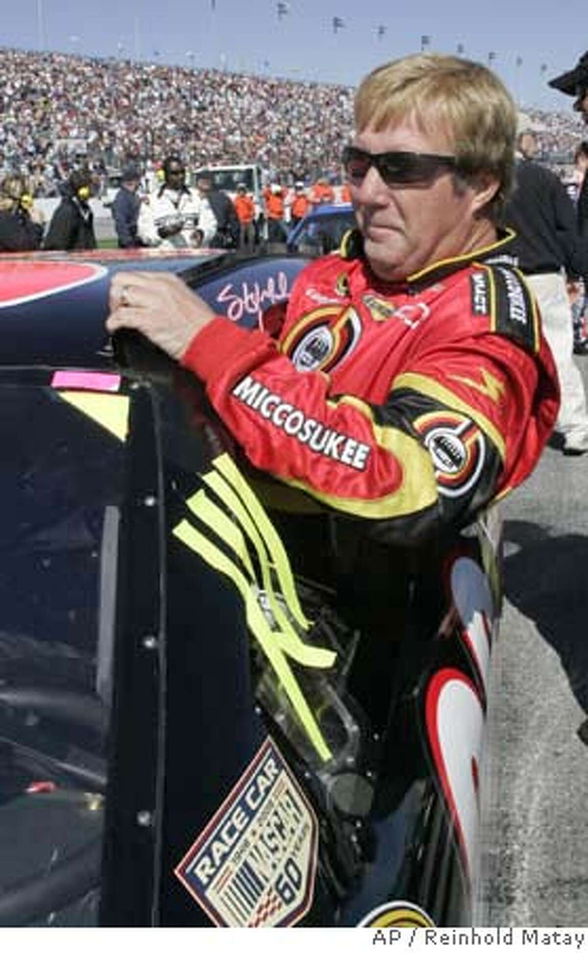 NASCAR driver Sterling Marlin gets in his car on pit road at Daytona International Speedway in Daytona Beach, Fla., Thursday, Feb. 14, 2008. Marlin was preparing for the Gatorade 150 qualifying race. (AP Photo/Reinhold Matay) EFE OUT