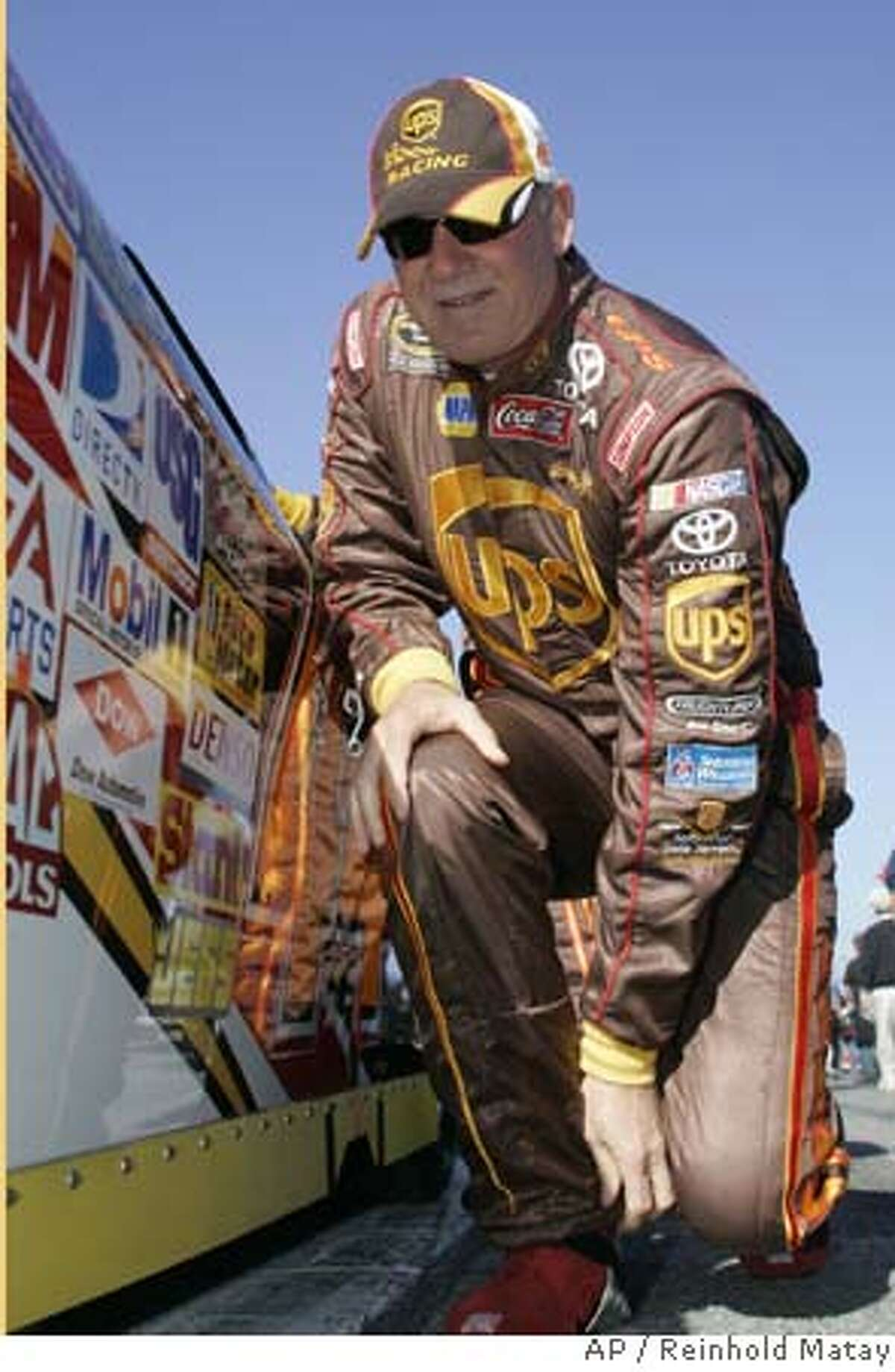 NASCAR driver Dale Jarrett prepares to get in his car at Daytona International Speedway in Daytona Beach, Fla., Thursday, Feb. 14, 2008. (AP Photo/Reinhold Matay) EFE OUT