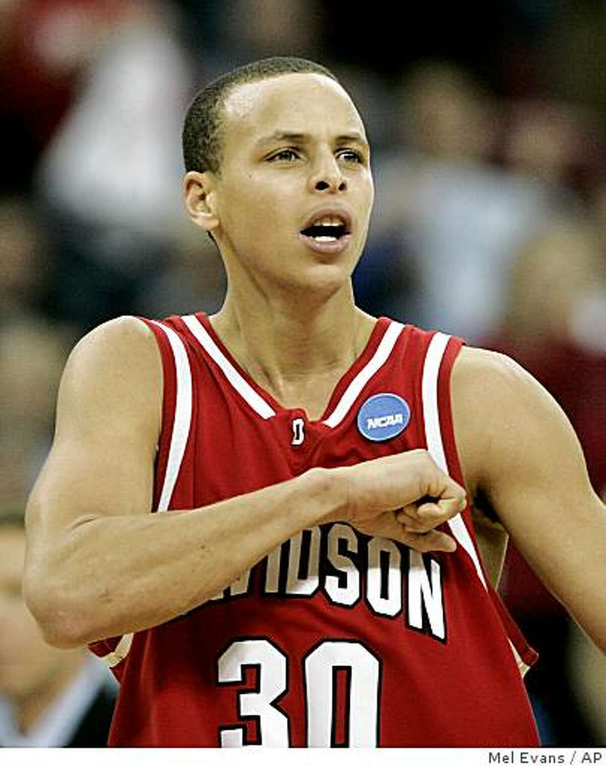 Davidson's Stephen Curry reacts following a basket during the second half of a first-round NCAA men's basketball tournament Midwest Regional game against Gonzaga in Raleigh, N.C., Friday, March 21, 2008. Davidson won 82-76. (AP Photo/Mel Evans)