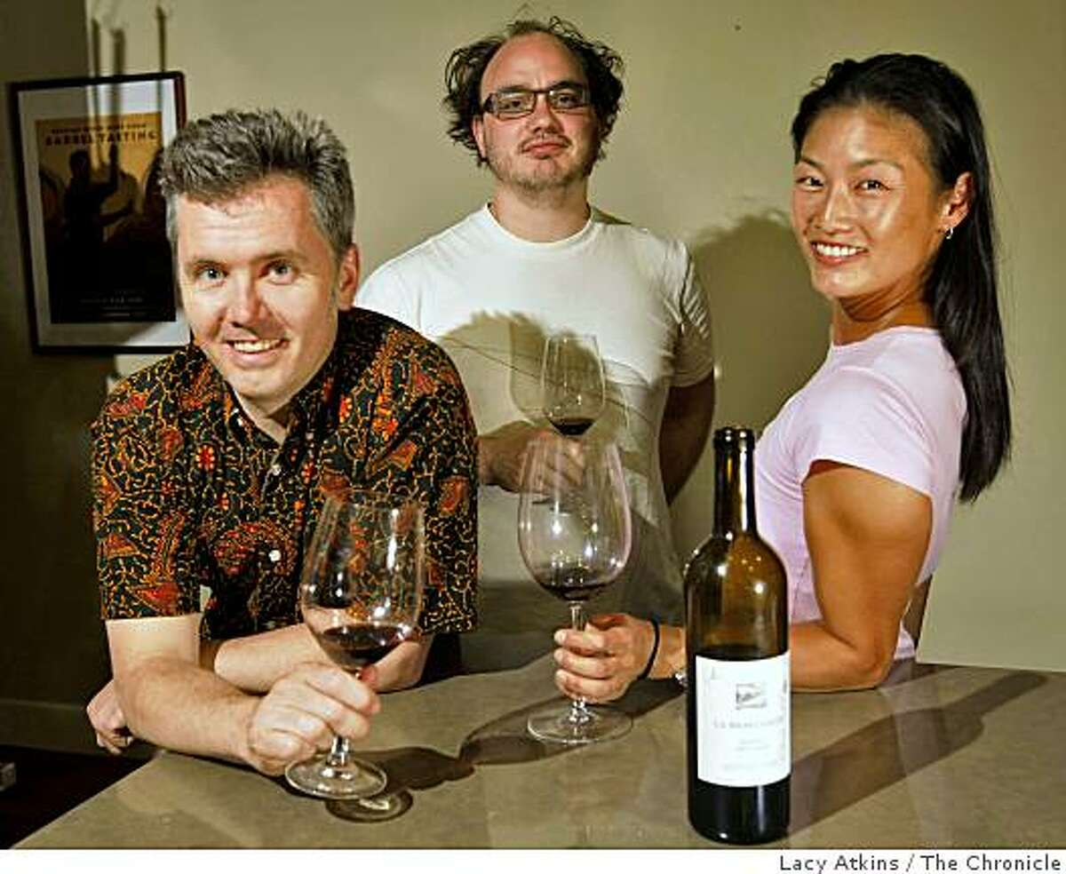Joe Russell, Dana Le and Sean-Michael Lewis enjoy bottles of wine together from their collection, Tuesday June 16, 2009, in San Francisco, Calif.