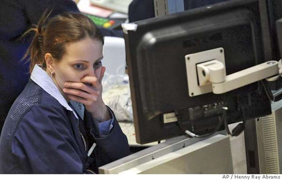 ###Live Caption:April Jarvis of Bear Wagner Specialists watches the early numbers on the floor of the New York Stock Exchange, Friday, Feb. 29, 2008. Stocks fell sharply after a series of economic and earnings reports and a further rise in oil prices stoked concerns about the health of economy. (AP Photo/Henny Ray Abrams)###Caption History:April Jarvis of Bear Wagner Specialists watches the early numbers on the floor of the New York Stock Exchange, Friday, Feb. 29, 2008. Stocks fell sharply after a series of economic and earnings reports and a further rise in oil prices stoked concerns about the health of economy. (AP Photo/Henny Ray Abrams)###Notes:April Jarvis###Special Instructions: Photo: Henny Ray Abrams