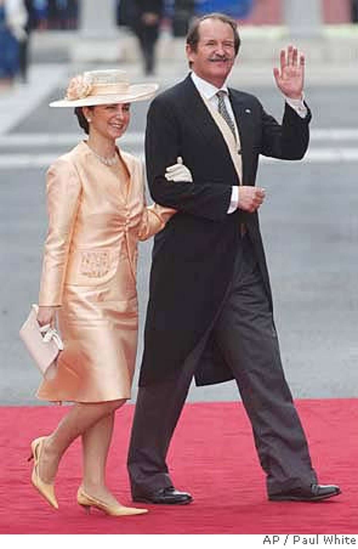 **APN ADVANCE FOR SUNDAY FEB. 17** Portugal's Duke of Braganza Duarte Pio, the next in line to the Portuguese throne, and his wife Isabel Herediaare seen arriving at Madrid's Almudena cathedral in this May 22 2004 file photo, to attend the wedding of Spain's Crown Prince Felipe to Letizia Ortiz. The centenary on Feb. 1 2008 of the assassination of Portuguese King Carlos I has taken Duarte Pio beyond the pages of glossy magazines and into the mainstream political debate. Pio would by birthright be sovereign if Portugal restored its monarchy, and he is using public interest in the Friday centenary of King Carlos I's assassination to make his case for a return to royal influence on a continent proud of its democratic traditions. He claims that at the start of the past century, before republicans deposed Carlos I's successor - Manuel II - by force in 1910, Portugal packed a bigger economic and diplomatic punch than it does now as one of the European Union's lightweights. (AP Photo/Paul White) **APN ADVANCE FOR SUNDAY FEB. 17**